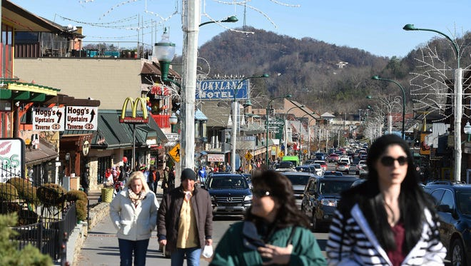 After seeing lots of tourists Dec. 9, 2016, for its grand reopening after the wildfire, downtown Gatlinburg, Tenn., has been slow to recoup normal holiday traffic.