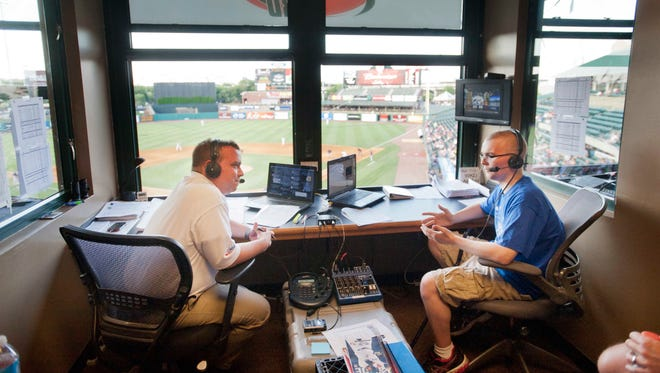 Louisville Bats' announcer Matt Andrews, left, shares his booth with Make A Wish youngster Gabe Kindermann, 18 as the Make A Wish Foundation is honored at Slugger Field. 06 July 2014