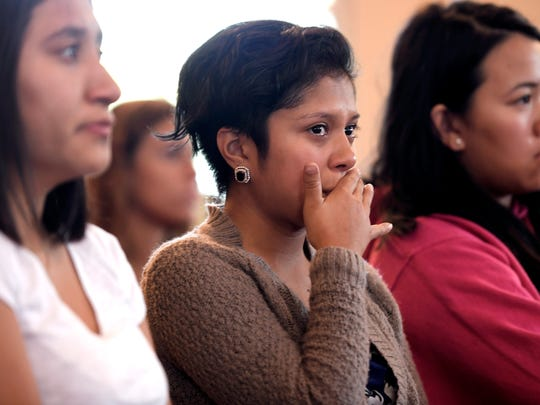 Lipscomb University student Anglea Mori,center, becomes emotional while listening to Lipscomb University DACA students share their stories on how they came to America.   Mori is not a DACA students but has friends that are DACA students. Lipscomb University held a DACA informational meeting for students and teachers at the school's chapel on Thursday, Sept. 7, 2017.  The meeting was held to address President Donald Trump's decision to end the DACA program. Lipscomb has 35 DACA students.