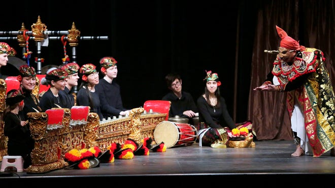Members of the Lawrence Academy perform with Gusti Ngurah Kertayuda, a guest dancer, during a Balinese Gamelan performance Saturday in Stansbury Theatre at Lawrence University.