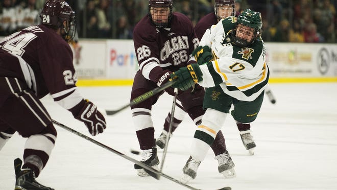Catamount forward Craig Puffer (17) shoots the puck for a goal during the men's hockey game between the Colgate Raiders and the Vermont Catamounts at Gutterson Field House on Wednesday night December 30, 2015 in Burlington.