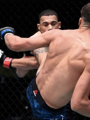 Taunton native and mixed martial arts fighter Randy Costa, right, delivers a first-round knockout kick to opponent Journey Newson during a recent bantamweight bout on ESPN+ Ultimate Fighting Championship.