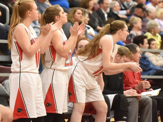 Norfork players cheer their team on against Wonderview.