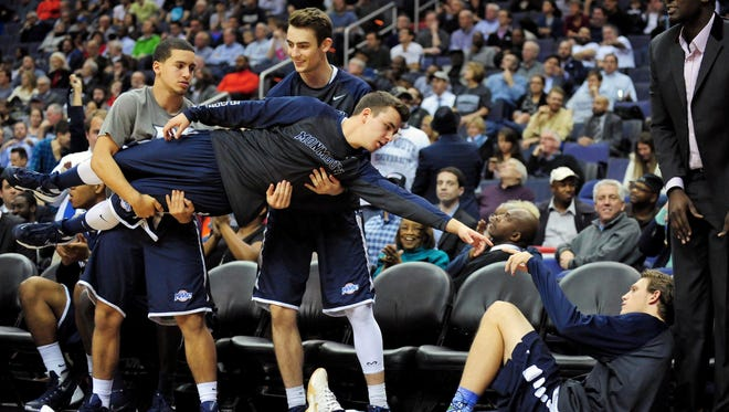 Monmouth Hawks bench players celebrate after a three pointer in the first half against the Georgetown Hoyas at Verizon Center. (Evan Habeeb, USA TODAY Sports)
