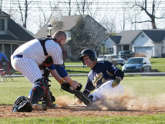 Elco's Nate Hostetter is tagged out at home plate by Northern Lebanon catcher Chase Dubendorf during the Vikings' 3-0 victory Wednesday.