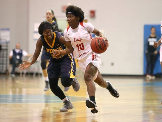 Leon's Jala Williams brings the ball upcourt as the