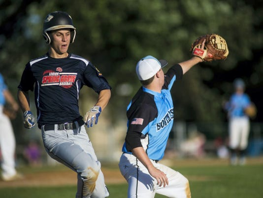Southwestern's Jimmy O' Boyle reaches for the ball as Spring Grove's Cam Sterner makes it safely to first base during Wednesday's American Legion game in Stoverstown. Southwestern won, 11-7.