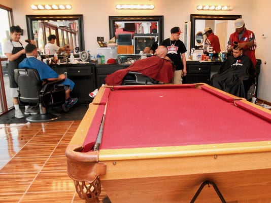 Robin Zielinski   Sun-NewsA pool table is available to customers as they wait to get their hair done on Friday at Underground Kuts.