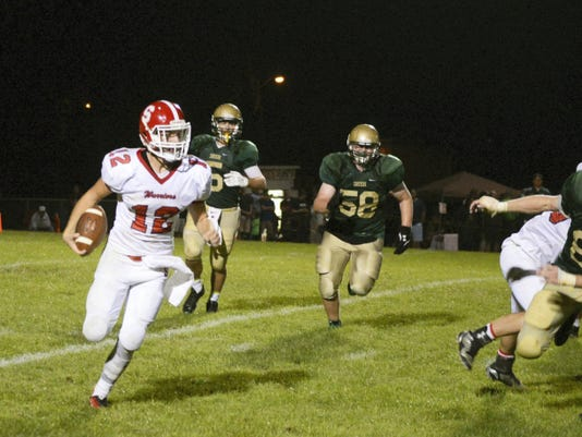 Susquehannock quarterback Josh Stoneberg (12) runs for a first down against York Catholic in the fourth quarter of the3 Warriors' 24-14 victory.