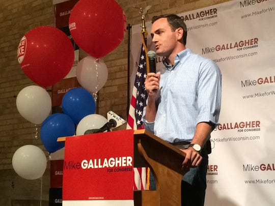Republican Mike Gallagher talks to supporters after winning the party's primary election Tuesday for the 8th Congressional District.