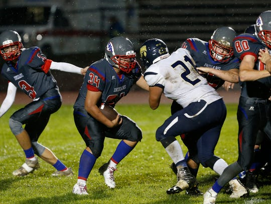 Owego's Gio Fabi carries the ball against Susquehanna