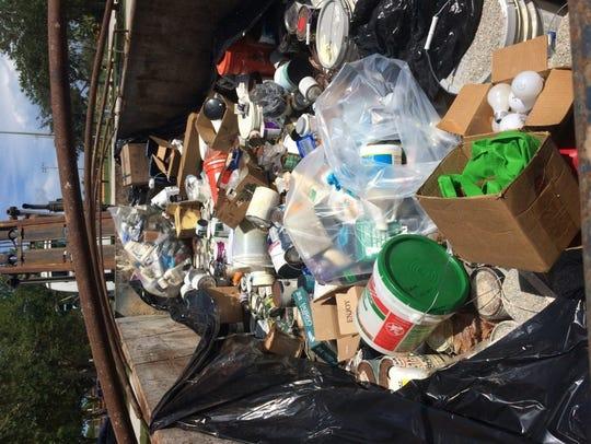 Household hazardous waste such as paint, florescent