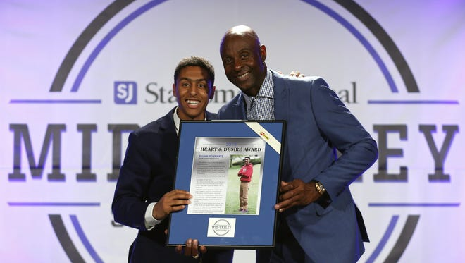 Elijah Schwartz from South Salem High School receives the Heart & Desire Award from Jerry Rice at the Mid-Valley Sports Awards on June 7, 2016 at the Salem Convention Center.
