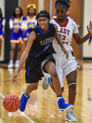 Canton's Jamaya Redd brings the ball up the floor past Germantown's Mirial Cannon during a MHSAA Region 3-5A girls basketball game on Monday.