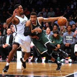 Giannis Antetokounmpo of the Milwaukee Bucks drives against Rondae Hollis-Jefferson of the Brooklyn Nets during the second quarter at Barclays Center in Brooklyn, N.Y.