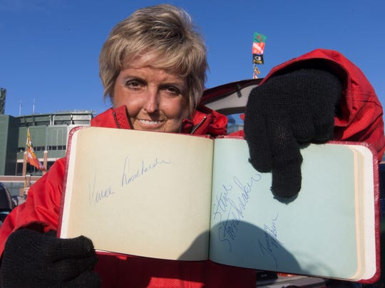 Debby Caven displays an autograph she got from legendary coach Vince Lombardi before the Green Bay Packers games against the Minnesota Vikings on Christmas Eve at Lambeau Field in Green Bay.