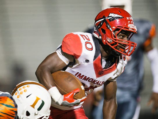 Immokalee High School's Shedro Louis breaks free from