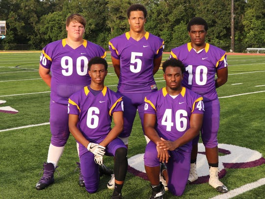 St Martinville's defensive lineup includes (front, from left) Javone Wiltz, Travon Pierre, (back, from left) Billy Williams, Marcus Cormier and Markell Chambers.