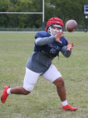 Brookfield East senior standout Sam Santiago-Lloyd catches a pass during practice this week. He plays both running back and outside linebacker.