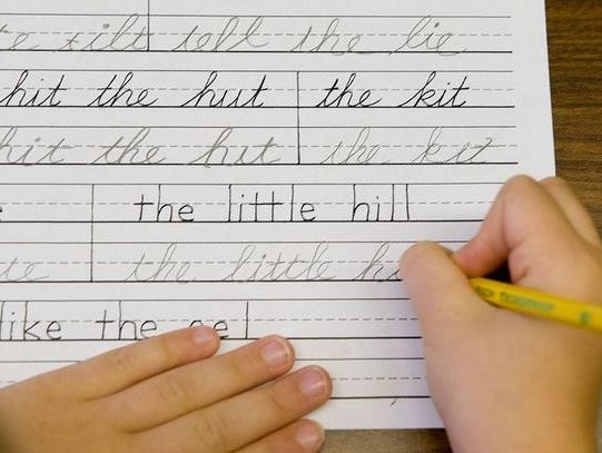 A student practices printing and cursive handwriting skills in a classroom at the Mountaineer Montessori School in Charleston, W.Va., on Sept. 19, 2009.