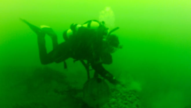 Divers Craig and Blair Bates explore a sunken mid-1800s canal boat that was discovered in Cayuga Lake. The wreck is under 70 feet of water, about a half mile off the lake's eastern shore, and two miles northwest of Aurora, N.Y.