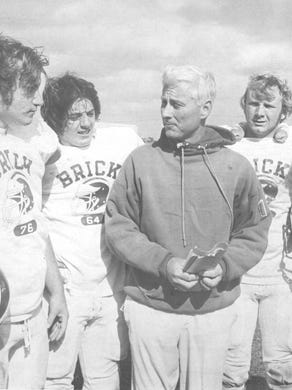 Brick  coach Warren Wolf goes over game plans with (left to right) Dennis Filippone, Paul Lawrence, Mark Heil and Steve Filippone.on Nov. 7, 1973.