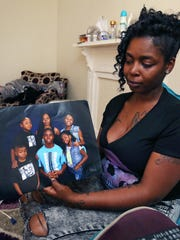 Shannon Swanson, 33, is the mother of 10-year-old Deshaun Swanson, who was shot and killed Sept. 19, 2015. Two days later, she showed a family picture in her home in the 1000 block of Eugene Street.