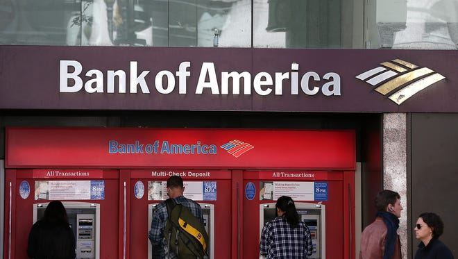 Customers use an ATM at a Bank of America branch office in San Francisco,