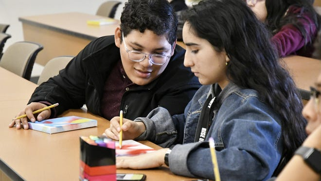 Elian Andrade, 17, and Magdalena Villasenor, 16, of Woodlake take part in an ARTivism workshop at the Rise Up As One Youth Summit at COS on Saturday.