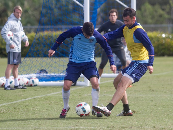 Andrew Jacobson and David Villa practice with their