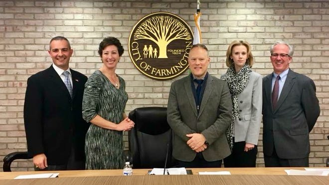 The new Farmington City Council was sworn in Monday, including Joe LaRussa (from left), Sara Bowman, Steve Schneemann, Maria Taylor and Bill Galvin. Schneeman replaces Galvin as mayor, and Bowman is the new mayor pro tem.