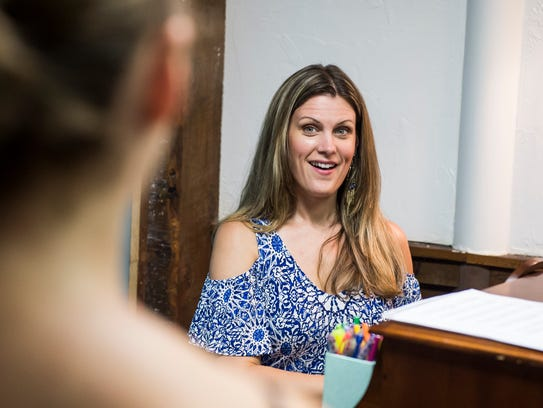 Courtney Ross teaches a voice lesson to Gillian Sturtz,