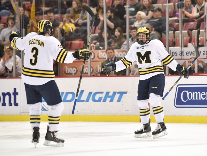 Michigan's Joseph Cecconi (3) celebrates with Cutler