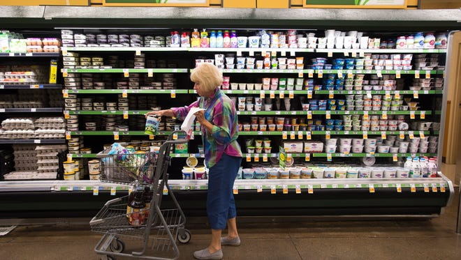 Trish Murphy shops for groceries  at King Soopers at 2602 S. Timberline Road in Fort Collins. The store is eliminating 24-hour service at the Taft Hill Road store on Feb. 3.