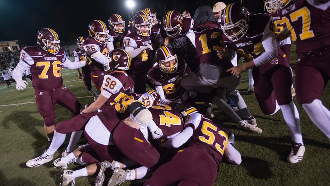 Windsor High School celebrates a 56-55 overtime win against Skyline at H.J. Dudley Field on Friday.