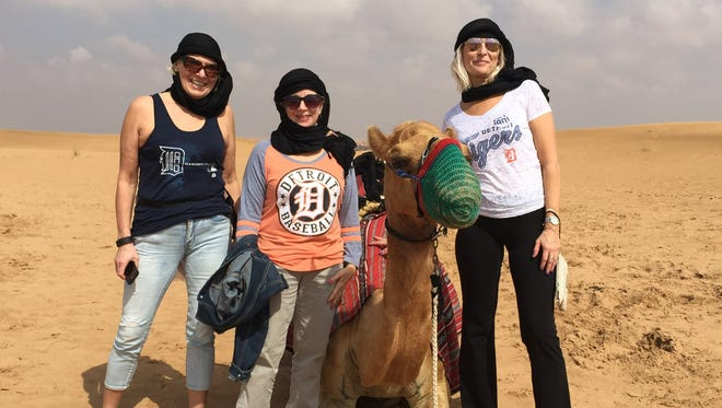 Angelika Scholz (L) of Germany and Donna Serement (R) of Grosse Ile visited Linda Powell (C), formerly of Trenton and living temporarily on assignment in Dubai.The friends sported the D at the Dubai Desert Conservation Reserve in March 2017. The shirts were not planned by the friends!