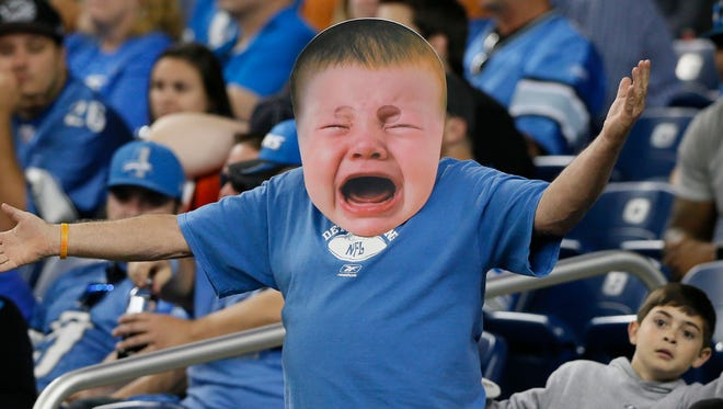 A Lions fan shows his frustration after during Sunday's game at Ford Field.
