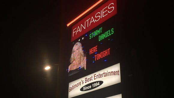 Fantasies Nightclub in Baltimore advertises the scheduled