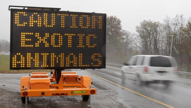 A highway sign on Interstate 70 warned that exotic animals were on the loose near Zanesville, Ohio, on Oct. 19, 2011, after their owner freed the animals and killed himself.