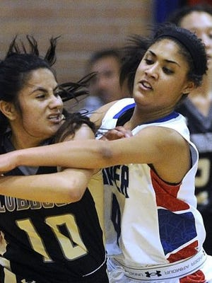 Cooper's Oshi Kerr (4) guards Lubbock High's Xena Garcia (10) during the fourth quarter of the Lady Cougars' 58-51 loss Jan. 26 at Cooper High School.