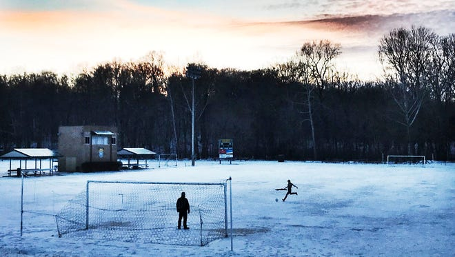 The winter weather may have postponed basketball games the prior week but it didn't stop one soccer player from practing goal shots on a snowy field at Floyd Central High School recently.