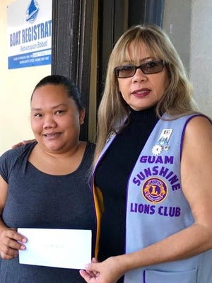 "The Guam Sunshine Lions Club, whose community service mission is ""Caring for the Sick and the Elderly,"" made a monetary donation to Tamhra Agulto, 36, on March 15 to help defray her off-island medical treatment expenses.Agulto, left, is shown with Lion Madeleine Sophie Losongco, her sponsor."