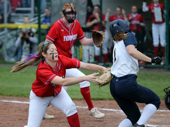Victor's Sarah Simmons is tagged out by Fairport's