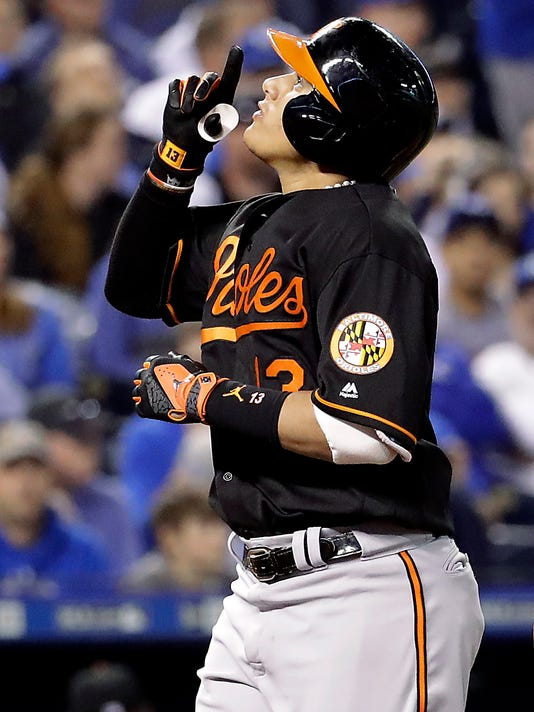 Baltimore Orioles' Manny Machado celebrates as he crosses the plate after hitting a solo home run during the sixth inning of a baseball game against the Kansas City Royals on Friday, April 22, 2016, in Kansas City, Mo. (AP Photo/Charlie Riedel)
