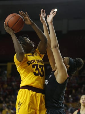 ASU's Charnea Johnson-Chapman (33) shoots against Stanford's Kaylee Johnson (5) during the first half at Wells Fargo Arena on January 7, 2018 in Tempe, Ariz.