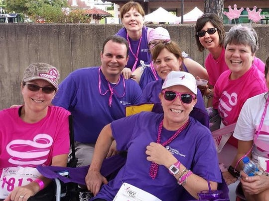 Angie Roberts (middle, second row) poses with friends at Cenla's Komen Race for the Cure in 2014.