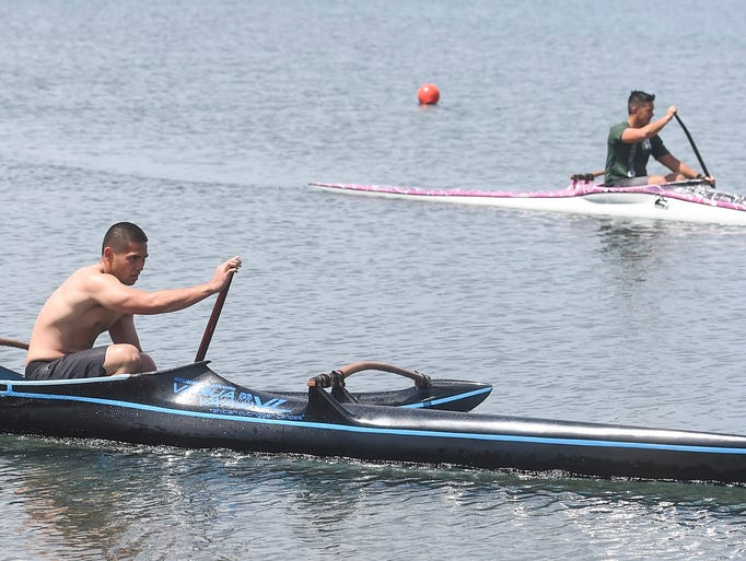 Competitors test their canoe paddling speed and endurance