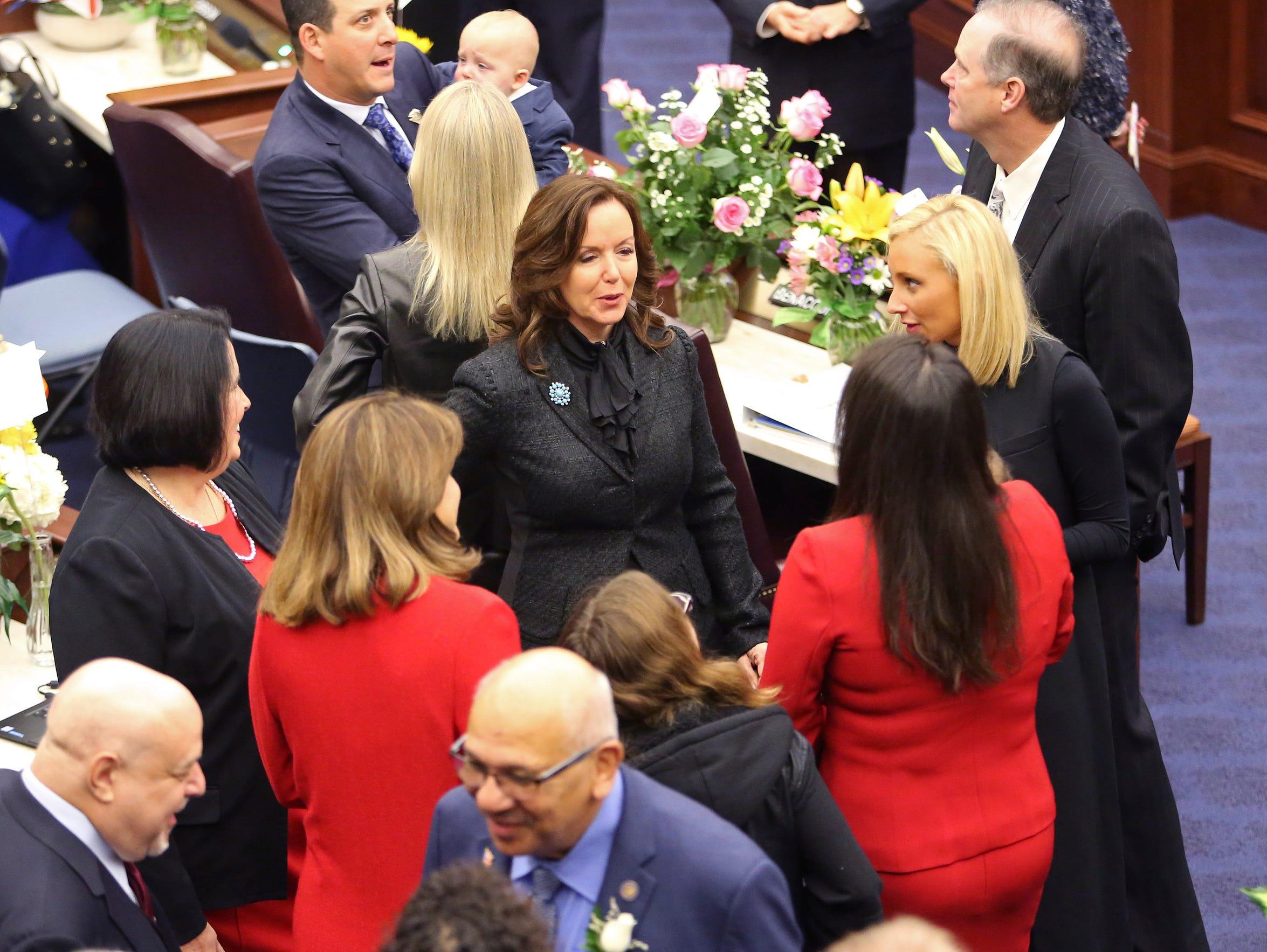 Florida senators meet and greet each other on the floor