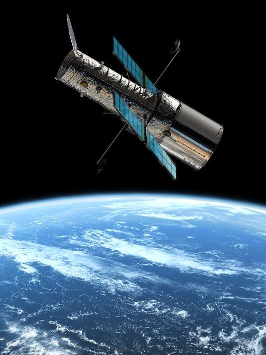 636403115135044802-hubble-earth.jpg