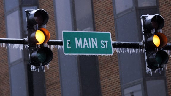 Icicles form on a traffic signal on East Main Street in Murfreesboro Monday, Feb. 16, 2015.